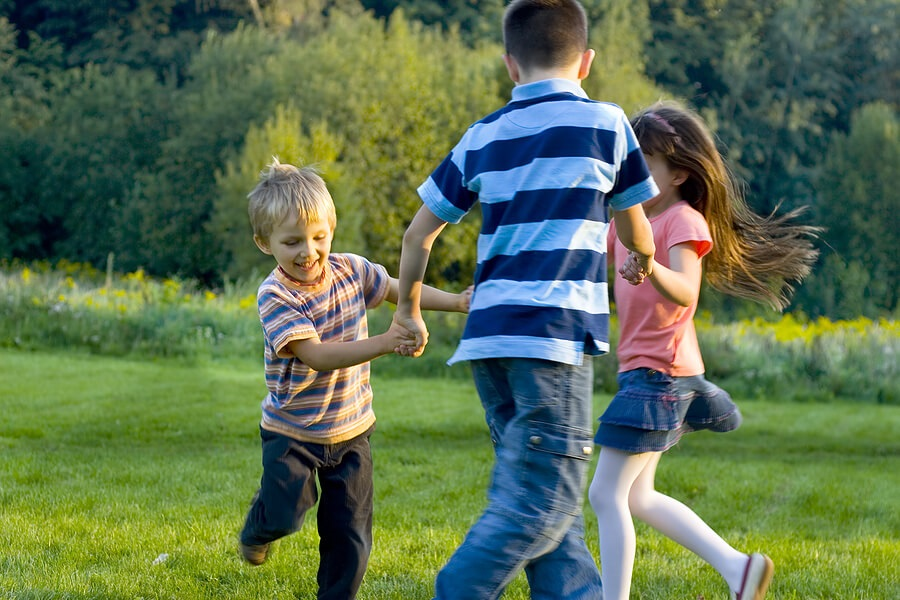 Fun Family Fitness, Three kids dancing outside for exercise