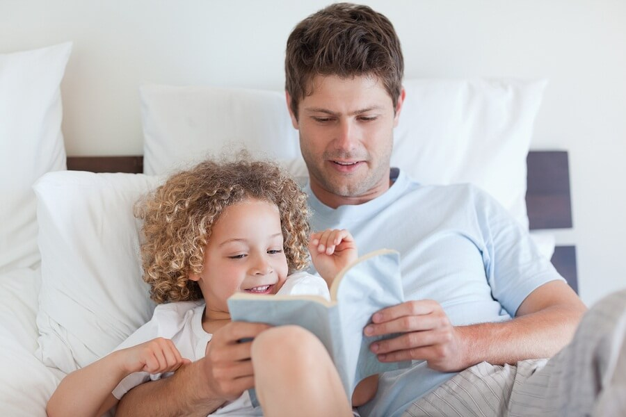 Father reading child bedtime story