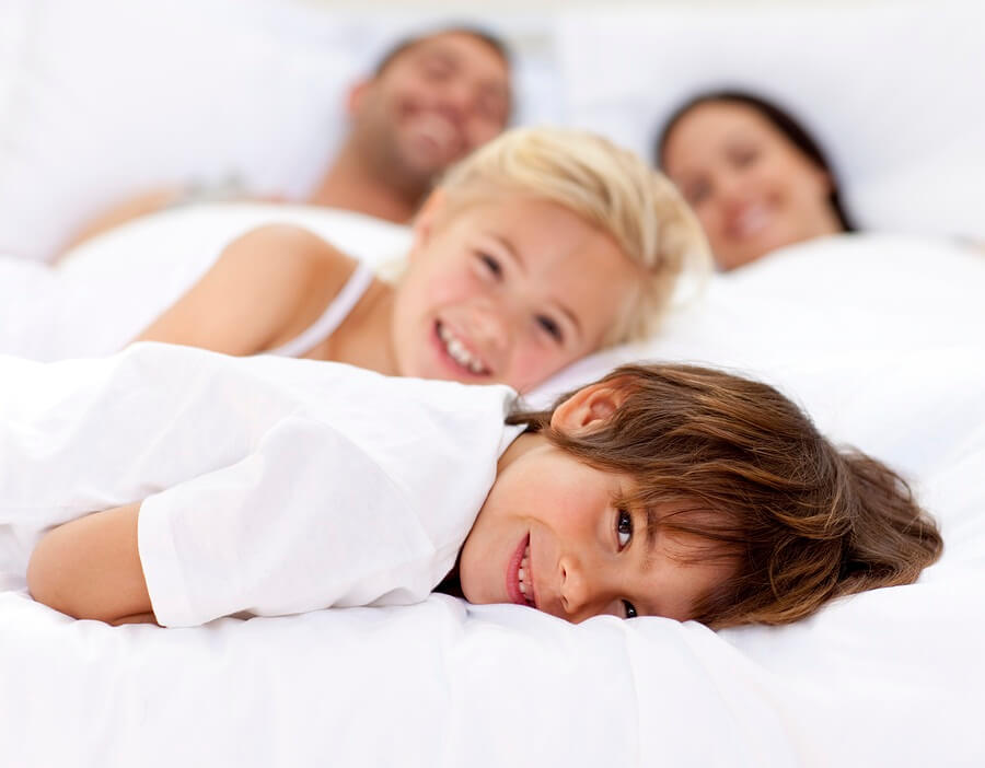 Parents and children in bed