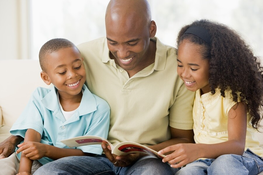 Father reading book to his children